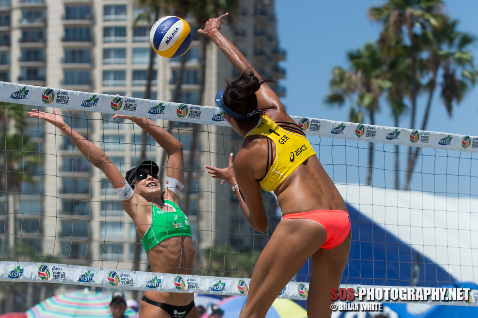 Taliqua Clancy tries to hit past Carolina Solberg Salgado (Brazil) at 2015 FIVB Long Beach Grand Slam
