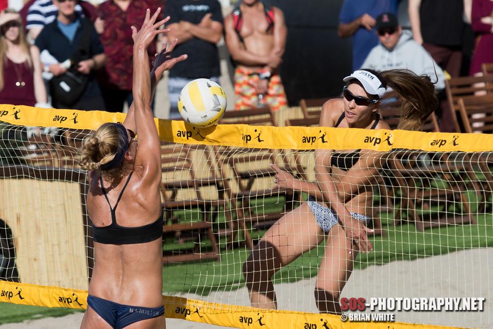 Irene Pollock shows off her hops at the net at an AVP Huntington Beach center court match